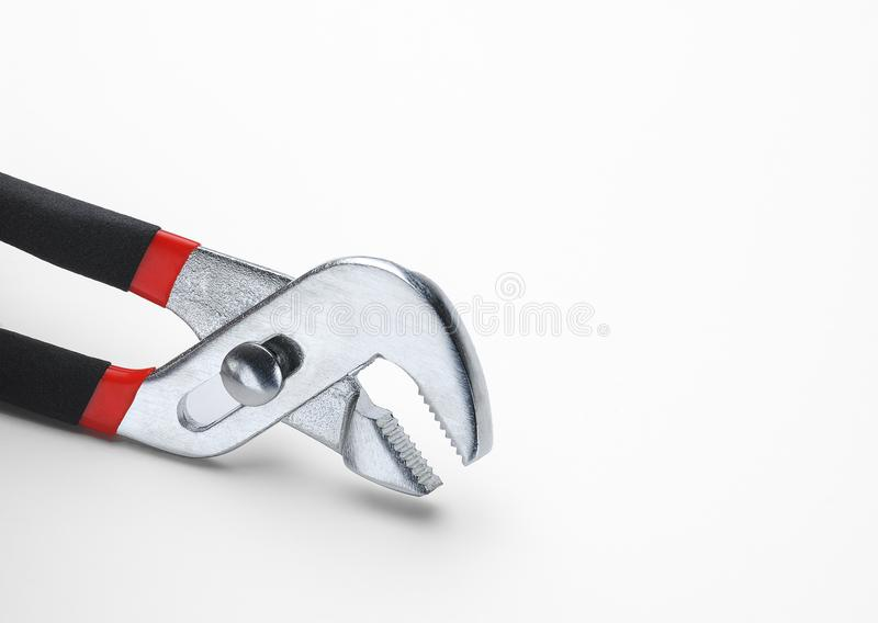 Adjustable Pliers on White. Channel lock adjustable pliers on white stock photos
