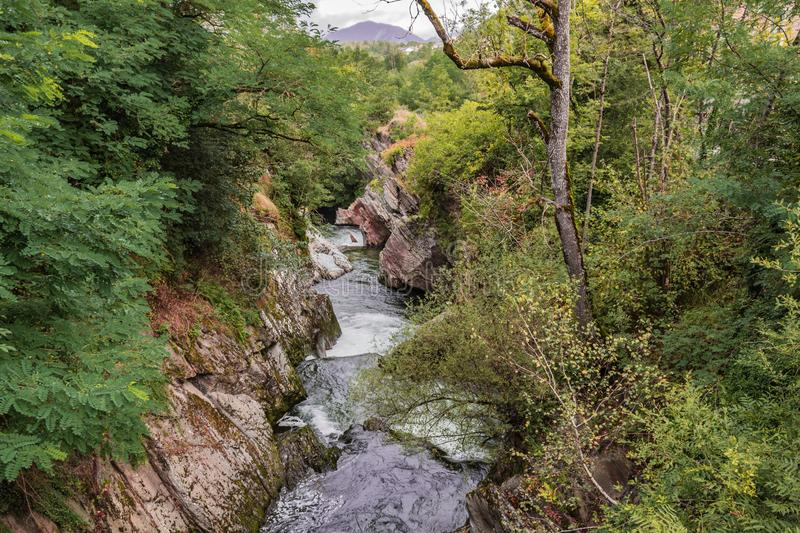 Channel of the river Ax-les-Thermes near the village of the same name. Ariege France. Typical landscape of the Pyrenees on the river Ax-les-Thermes near the royalty free stock images