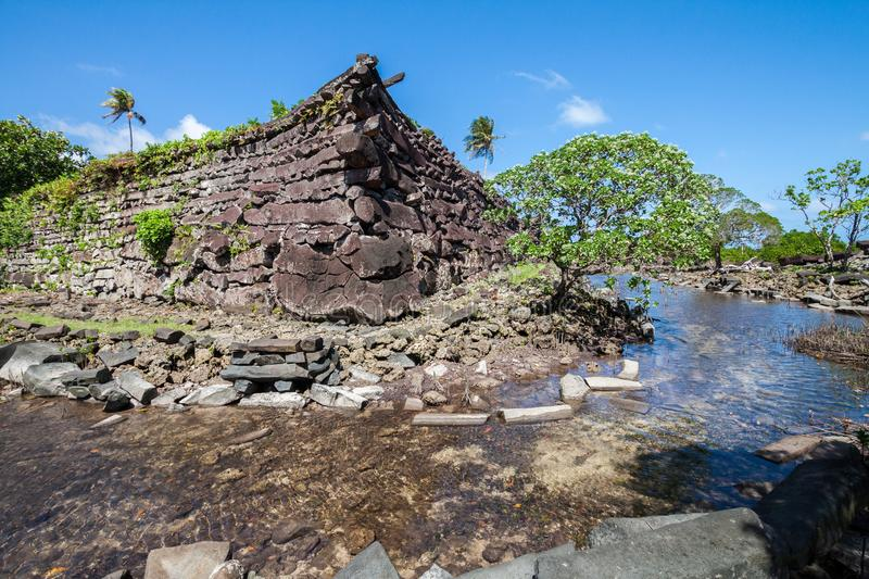A channel and town walls in Nan Madol - prehistoric ruined stone city. Pohnpei, Micronesia, Oceania. A channel and town walls in Nan Madol - prehistoric ruined stock photo