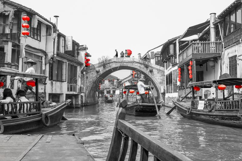 Zhujiajiao, ancient village with traditional canal with wooden boats and ancient bridge near Shanghai, China. Black, white, red  royalty free stock photo