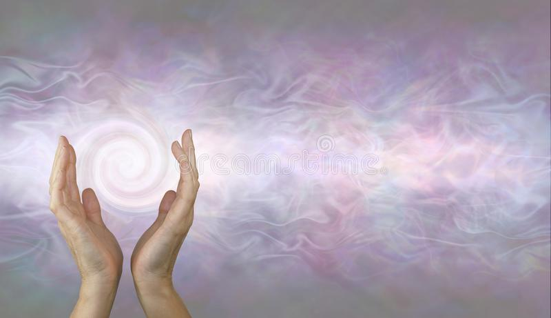 Channelling Vortex healing energy background. Female hands held parallel with a white spiralling vortex energy formation and pale pink blue grey misty ethereal stock photo