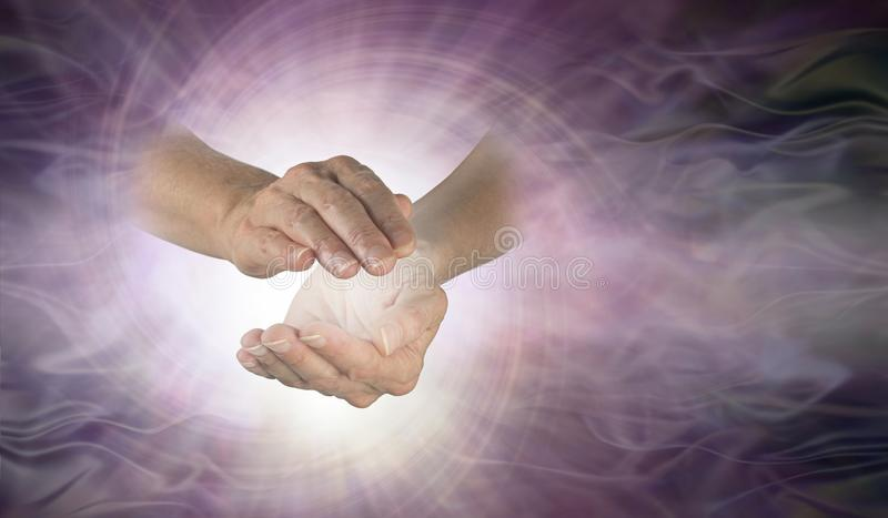 Channelling vortex spiral between hands stock image
