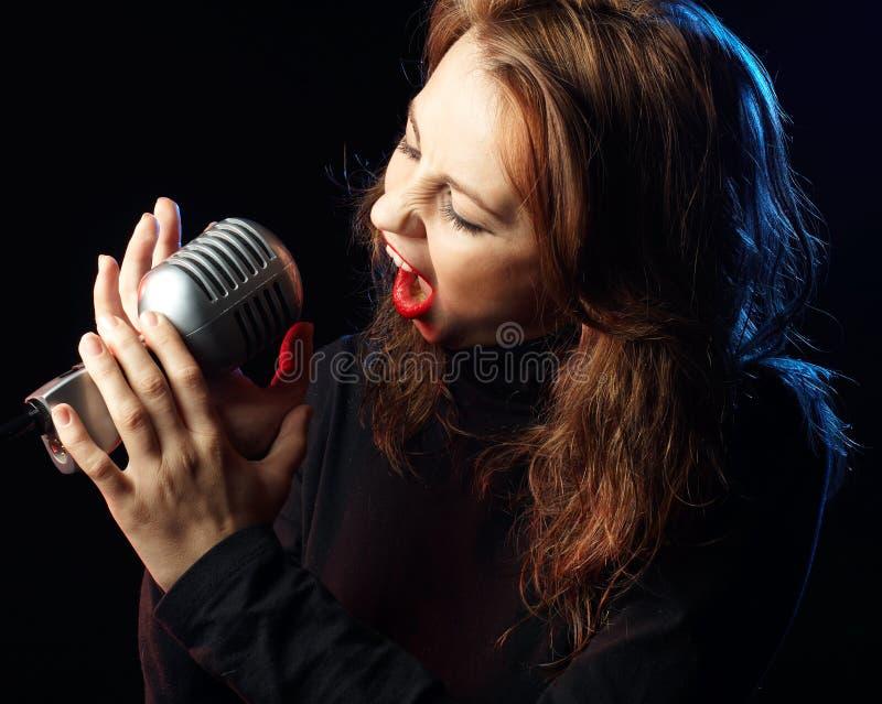 Chant de femme photos stock