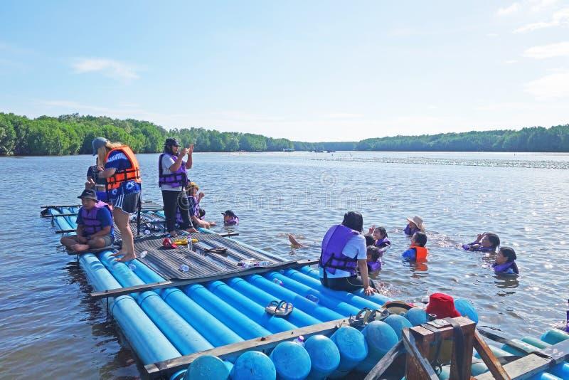 CHANTABURI, LAEM SING, THAILAND – 26 JULY 2019 Tourists floating on pvc pipe raft in the lake of Laem Sing stock photography