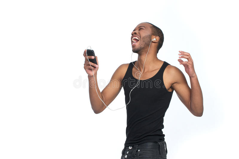 Chantez avec des écouteurs images stock