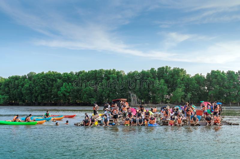 CHANTHABURI, THAILAND: APRIL 15, 2019 Unidentified  tourists relax on rafts and kayaking on the sea on april 15,2019 at Bang Chan. The No-Land Village stock images