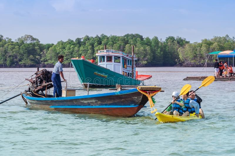 CHANTHABURI, THAILAND: APRIL 15, 2019 Unidentified  tourists relax on rafts and kayaking on the sea on april 15,2019 at Bang Chan. The No-Land Village royalty free stock photography