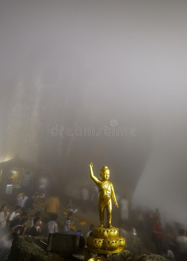 Foggy night People are worshiping the footprint in the rock on the top of Kitchakut Mountain royalty free stock image