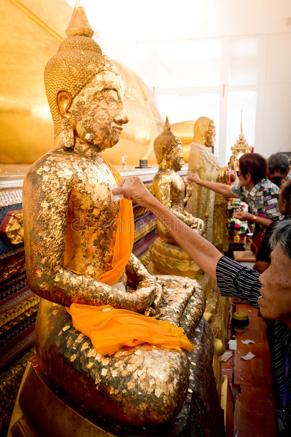 Chanthaburi , Thailand - MAY 11 : Thai Buddhist People doing cover Statue of Buddha with Gold Leaf. This is Tradition Culture. Of Thai Buddhist on May 11, 2017 stock images