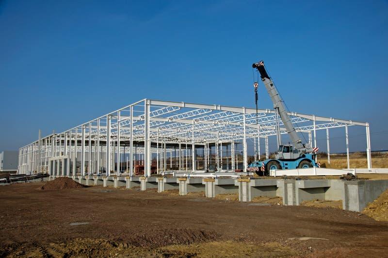 Chantier de construction d'entrepôt moderne image libre de droits