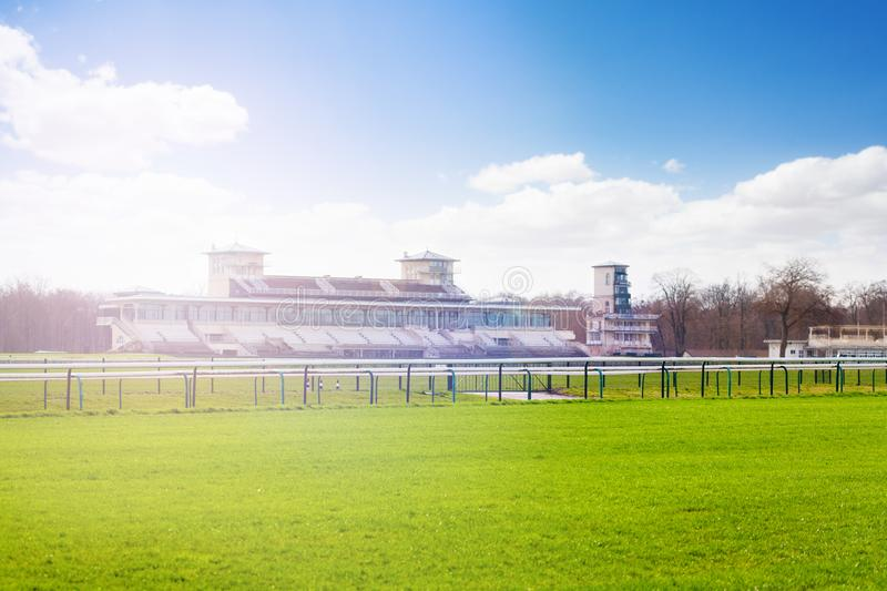 Chantilly racecourse with stands at sunny day. French oldest racecourse with stands at sunny day, Chantilly royalty free stock photos