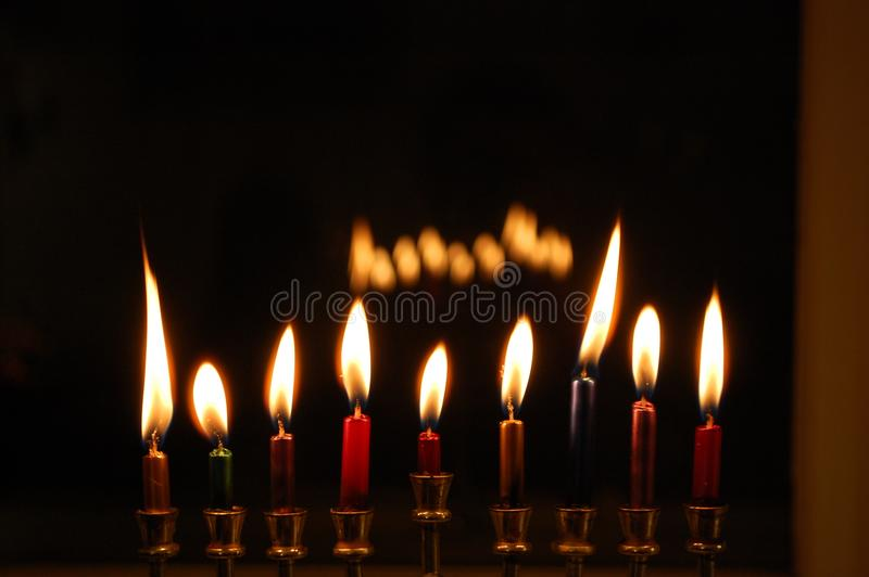 Chanukah Candles. Burning low in the menorah on the last night of the holiday stock photo