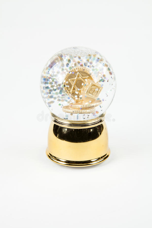 Chanukah Snow Globe. A Hanukkah snow globe against a white background stock images