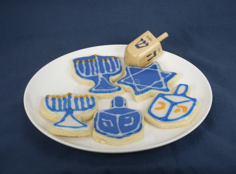 Chanukkah Cookes och en Dreidel arkivfoto