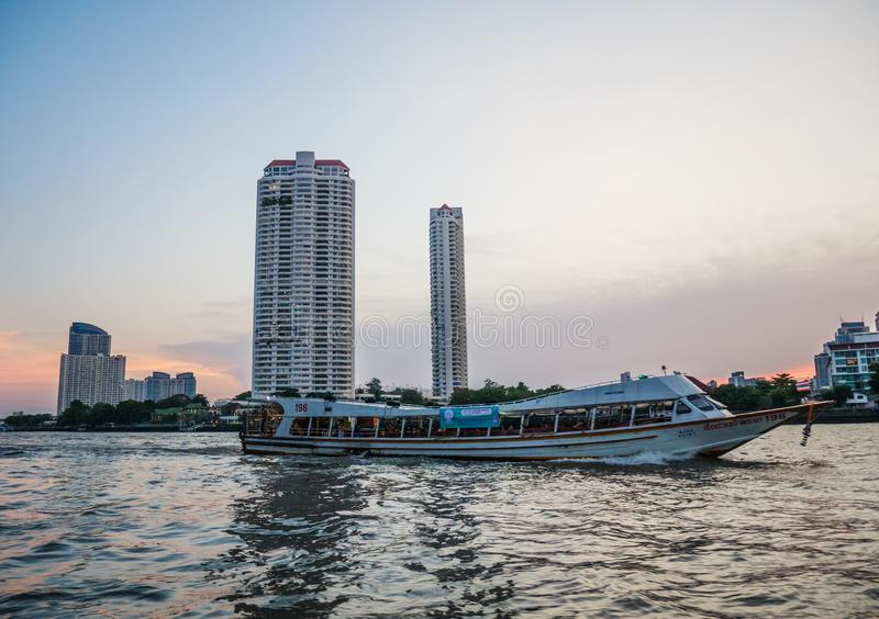 People use passenger boat to travel in Bangkok. Chao praya river,Bangkok,Thailand 13 Apr 2019: People use passenger boat to travel and commute in Bangkok royalty free stock photography