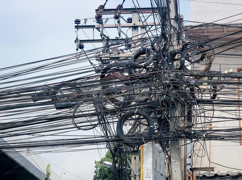 The chaos of cables and wires for commutation. On every street in Bangkok, Thailand stock photos