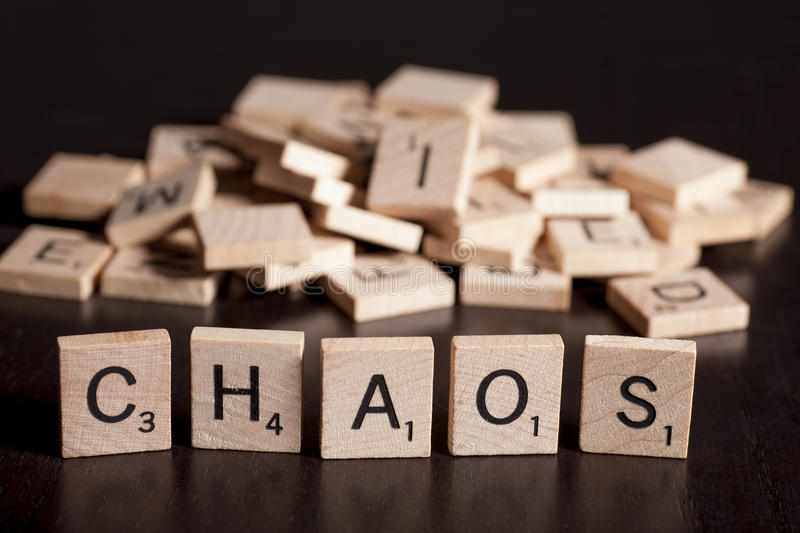 Chaos. Tha word chaos spelled with scrabble letters royalty free stock photo
