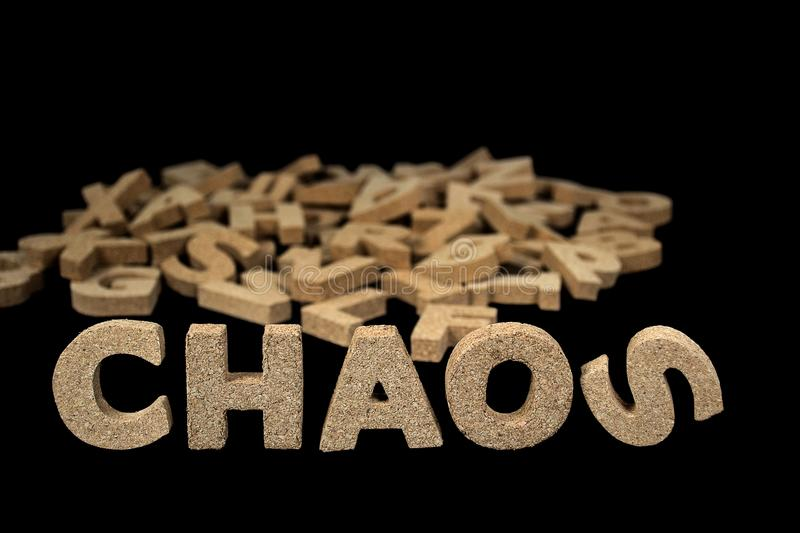 Chaos word in cork block letters royalty free stock photos