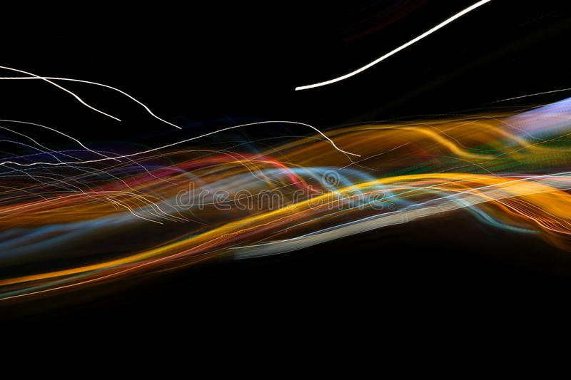 Chaotic colorful lights. On black background royalty free stock images