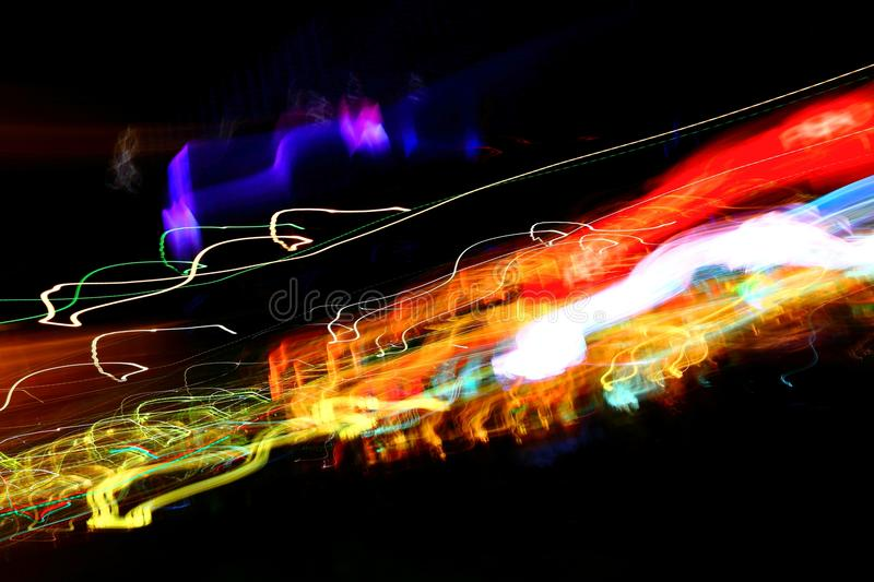 Chaotic colorful lights. On black background stock photos