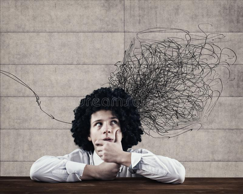 Chaotic mind bsuiness. Businessman and a chaotic lines drawn on wall stock photo