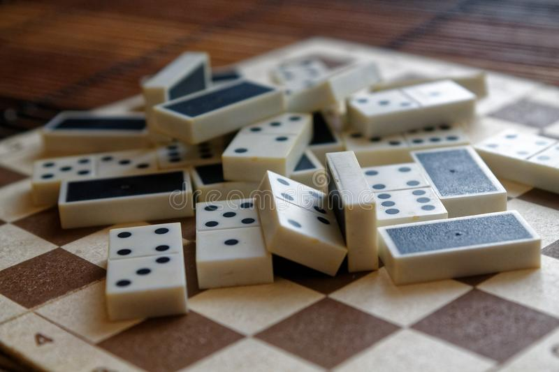 Download Chaotic Pile Of Domino Pieces On The Bamboo Brown Wooden Table  Background Stock Image