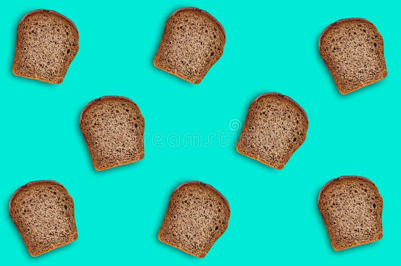 Chaotic scattered many rectangular pieces of fresh rye bread on green table on kitchen. Seamless pattern. Top view. Dieting concept stock photo