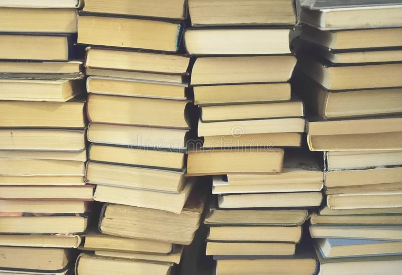 Chaotic stack of old. Books background, filter applied stock images