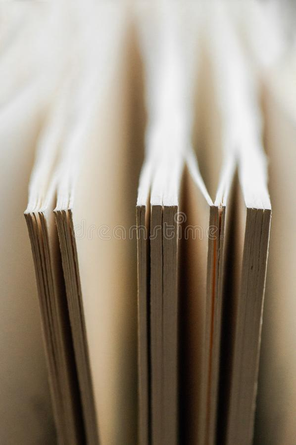 Chaotic stack of old books pastel colors, selective focus with copy space. Background from books. Books close up. royalty free stock image