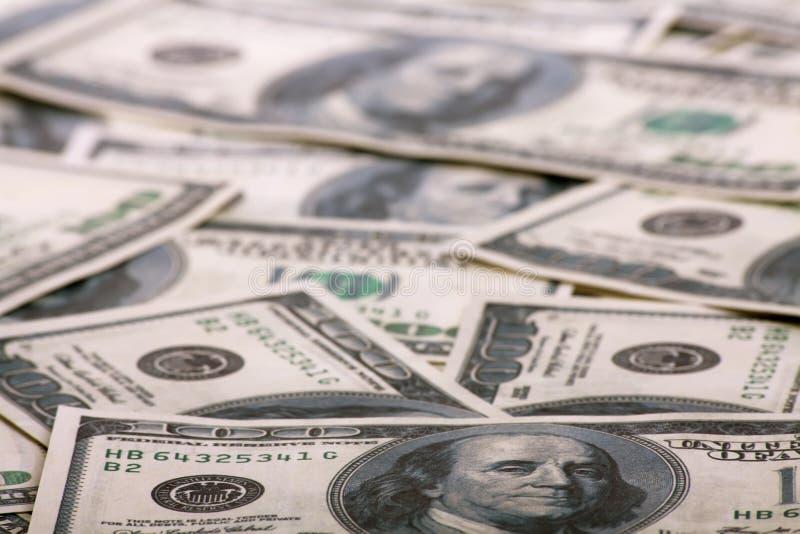 Chaotically lyings one hundred greenbacks royalty free stock photo