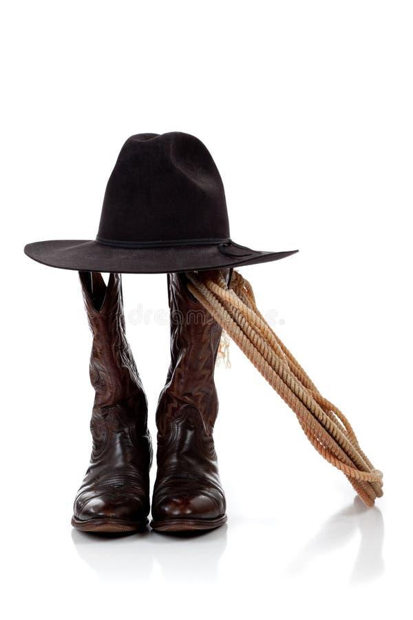 Chapéu de cowboy, carregadores e lasso no branco imagem de stock royalty free
