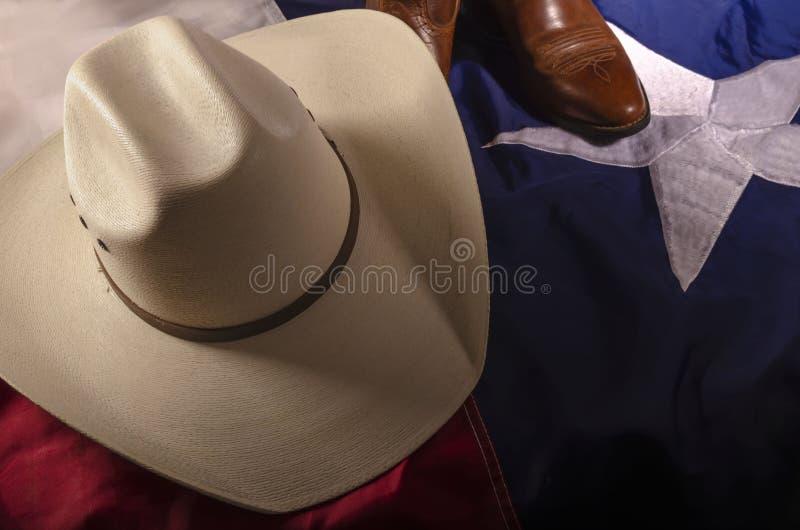 Chapéu de Cowboy e bandeira do Texas fotografia de stock royalty free
