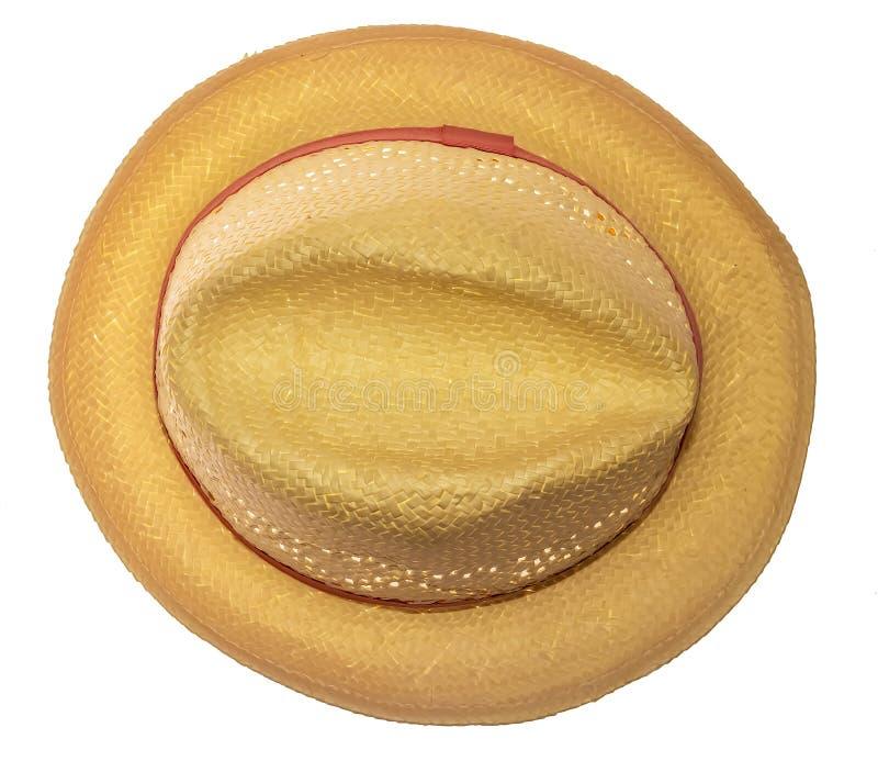 Chapéu de palha amarelo na opinião superior do fundo branco fotos de stock