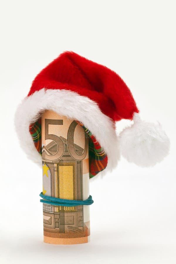Chapéu de Santa com a cédula do euro cinqüênta imagem de stock
