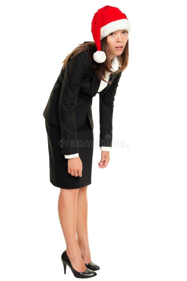 Chapéu desgastando cansado de Santa da mulher de negócio do Natal imagem de stock