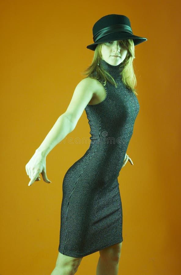 Chapéu desgastando da mulher - 2 fotos de stock royalty free