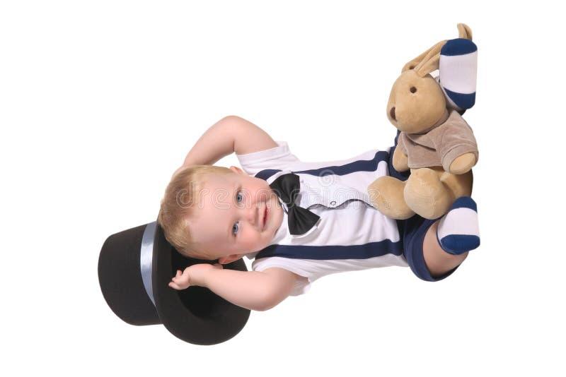 Chapéu do cilindro da terra arrendada do mágico do bebé fotografia de stock royalty free
