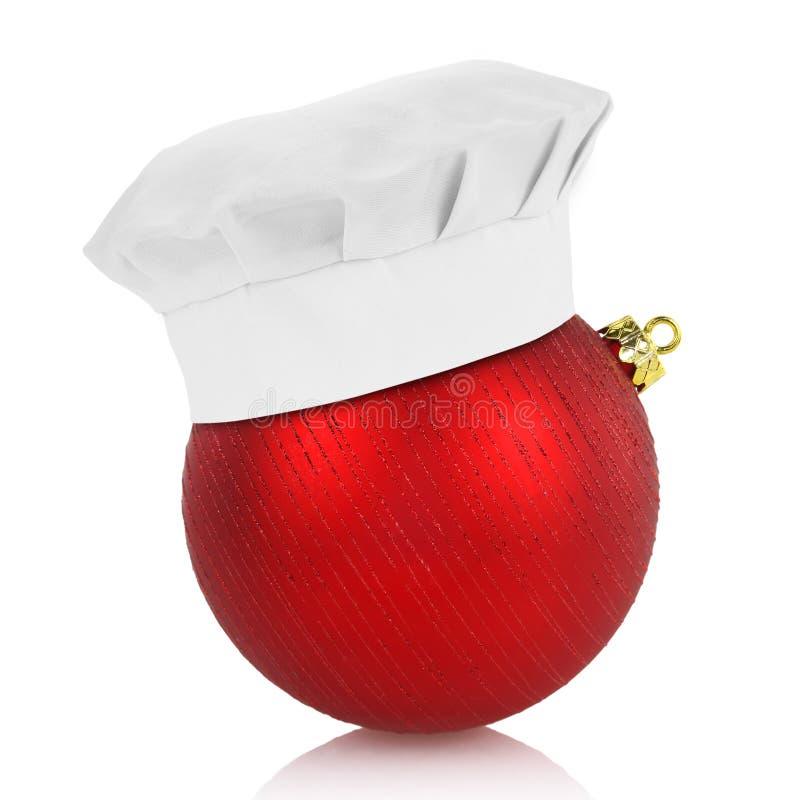 Chapéu do cozinheiro chefe na bola elegante do Natal foto de stock royalty free