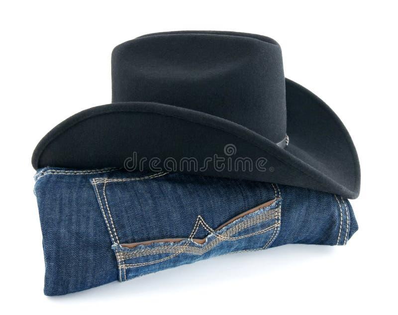 Chapéu e calças de ganga de cowboy imagem de stock