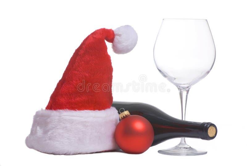 Chapéu e vinho de Santa imagem de stock