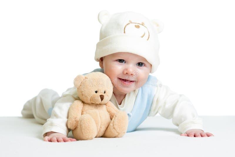Chapéu engraçado weared bebê com brinquedo do luxuoso imagens de stock