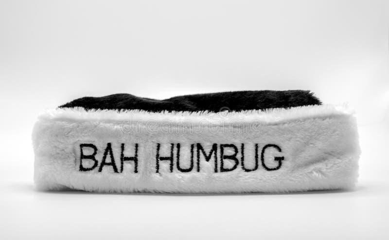 Chapéu forrado a pele com farsa de Bah nela em preto e branco imagens de stock