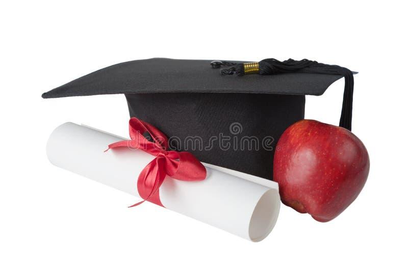 Chapéu graduado, vermelho; rolo da maçã e do papel imagem de stock