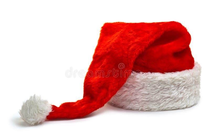 Chapéu longo de Papai Noel, encontrando-se em um fundo branco fotos de stock royalty free