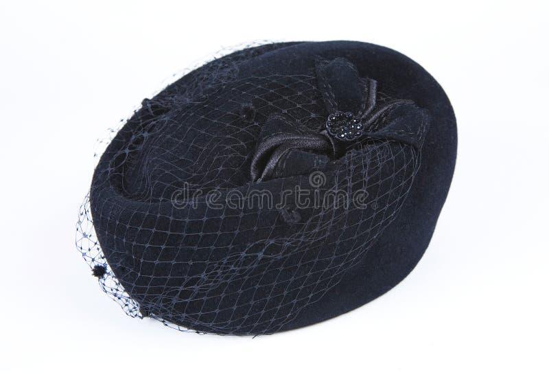 Chapéu negro fêmea com um véu isolado em um fundo branco fotografia de stock royalty free