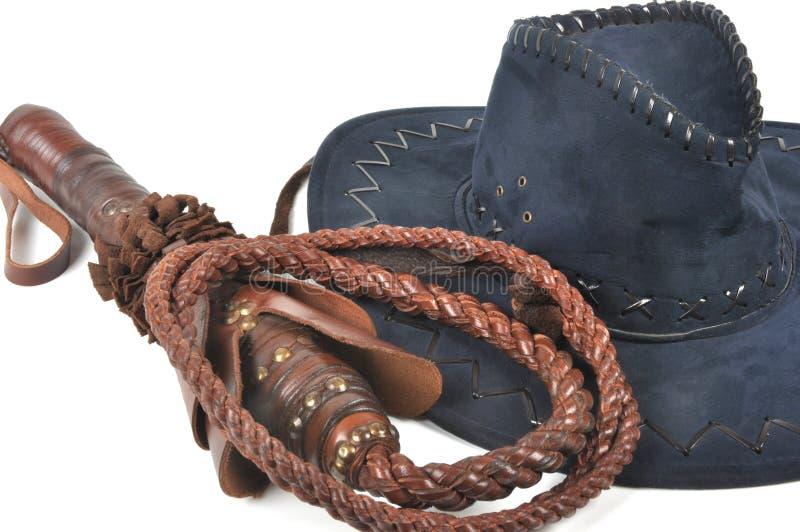 Chapéu trançado do chicote & de cowboy imagens de stock