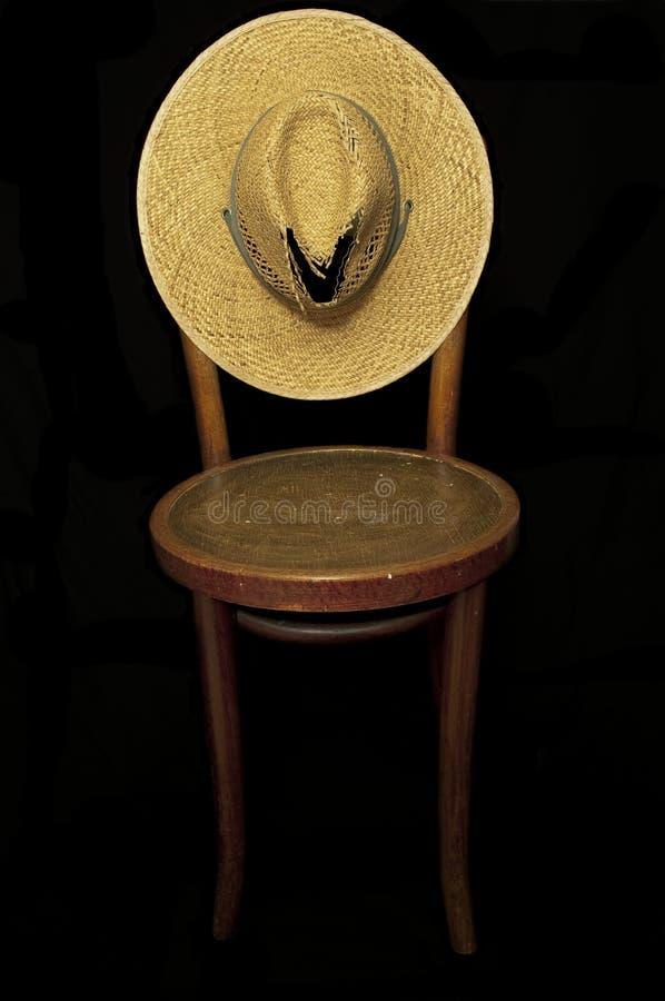 Chapéu velho, cadeira velha imagem de stock