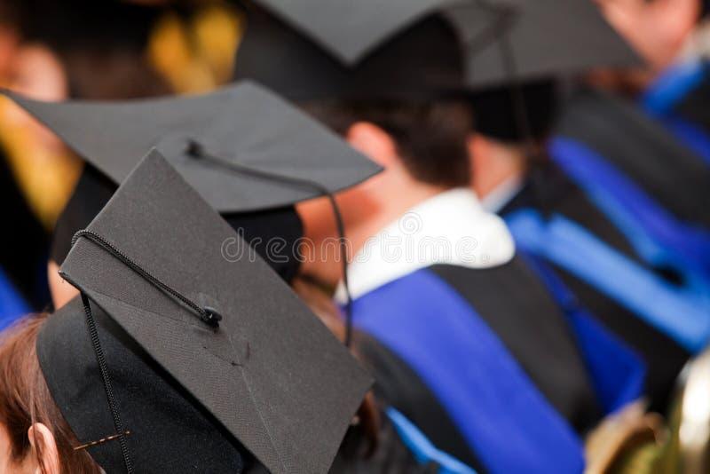 Chapéus da graduação imagens de stock