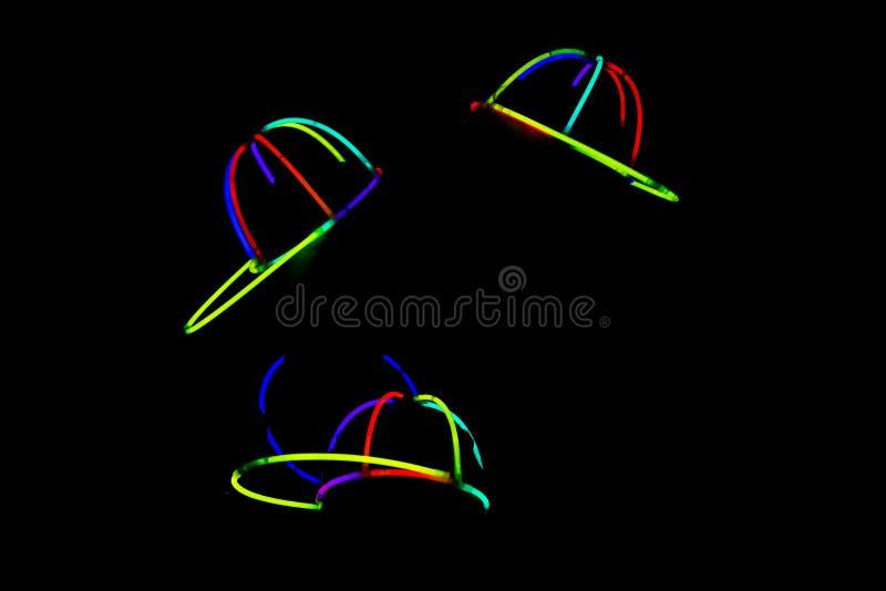Chapéus de incandescência no partido foto de stock