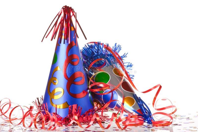 Chapéus, flâmulas e confetti do partido fotografia de stock